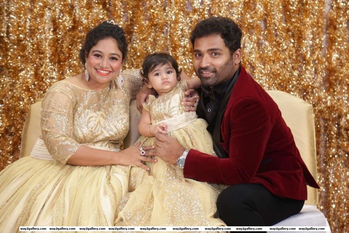 Lalitha and Shobi pose for photographers during their daughter Syamantakamani Ashvikas birthday bash