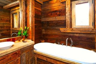 Cottage bathroom with wood wall panels.