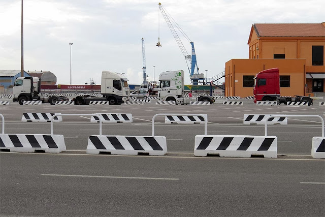 Semi-tractors parked inside the cargo port area, Livorno