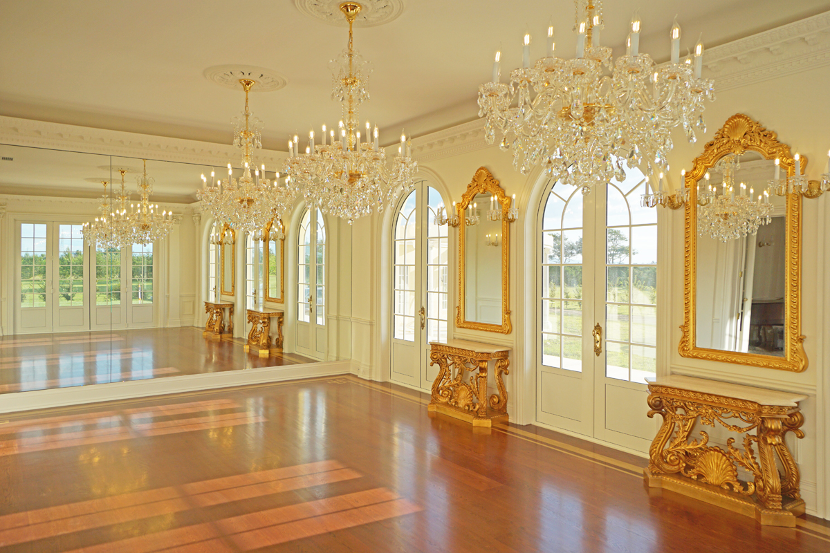 Then there are the gilded consoles and pier lights above between each of the french windows