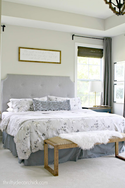 Master bedroom with tufted headboard and art over bed