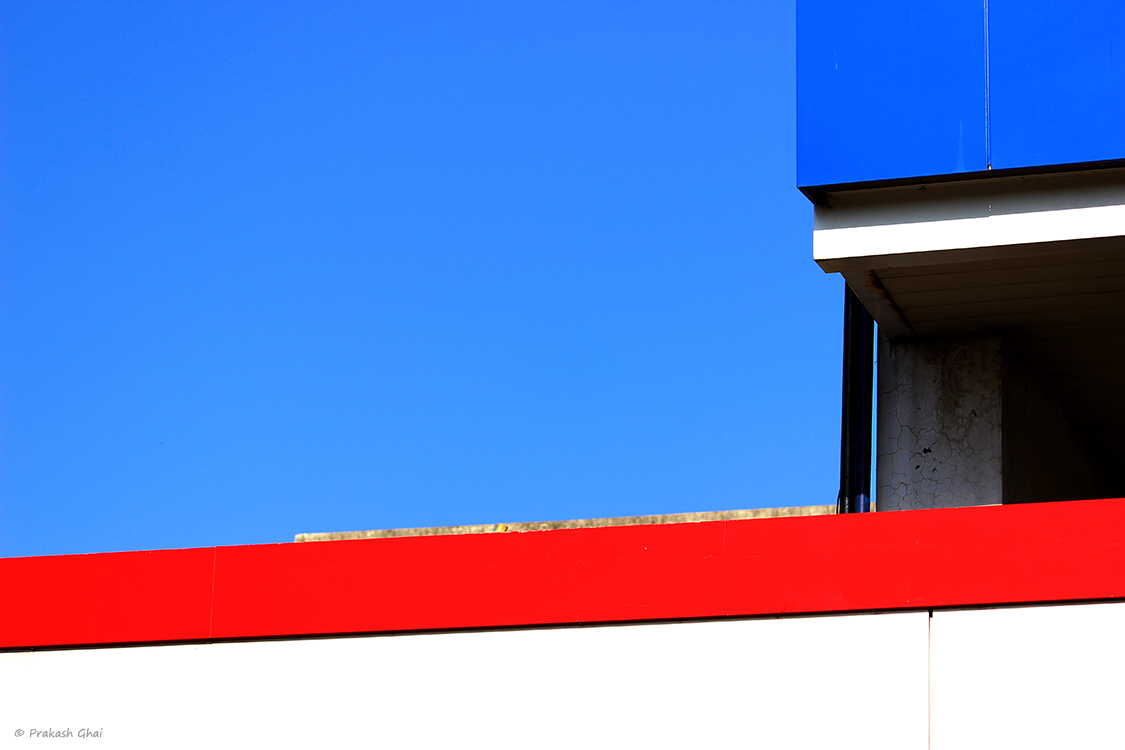 A minimalist photo of Red and blue lines at a petrol pump in Jaipur