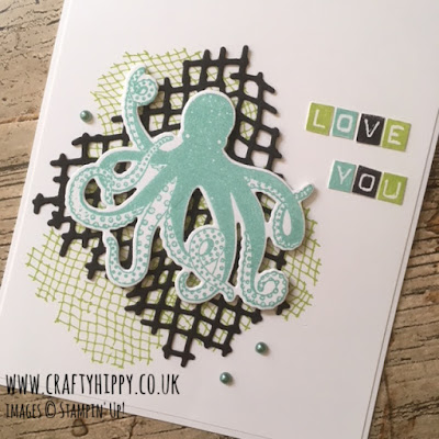 This image is a close up of a handmade card with a Coastal Cabana octopus and the sentiment 'love you' and is made with the Sea of Textures and Labeler Alphabet stamp sets from Stampin' Up!