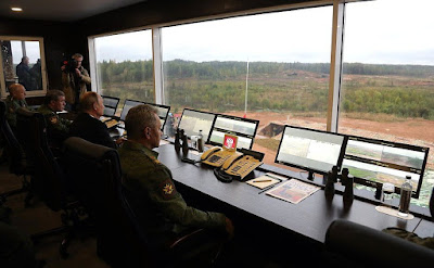 Vladimir Putin and Sergei Shoigu in the command center at the Luzhsky training ground.