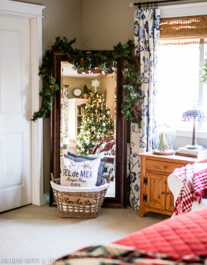 Large mirror in master bedroom with Christmas decor