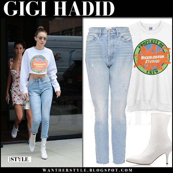 Gigi Hadid in white cropped sweatshirt, jeans and white boots stuart weitzman clingy what she wore june 14 2017