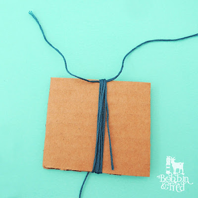 How to make a tassel tutorial, step 1, wrap thread around cardboard