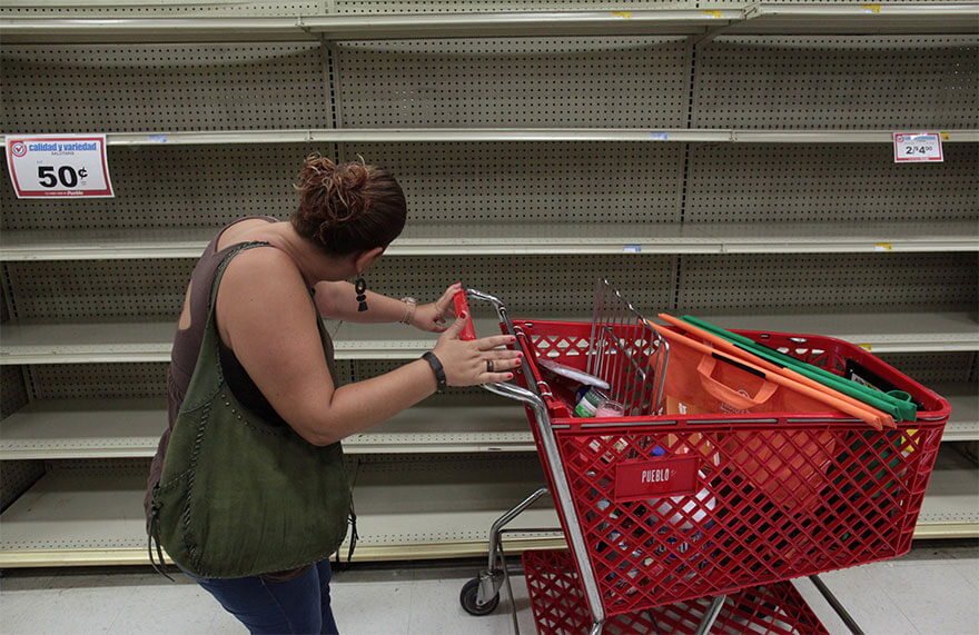 30 Shocking Pictures That Show How Catastrophic Hurricane Irma Is - A Woman Looks At Empty Shelves That Are Normally Filled With Bottles Of Water