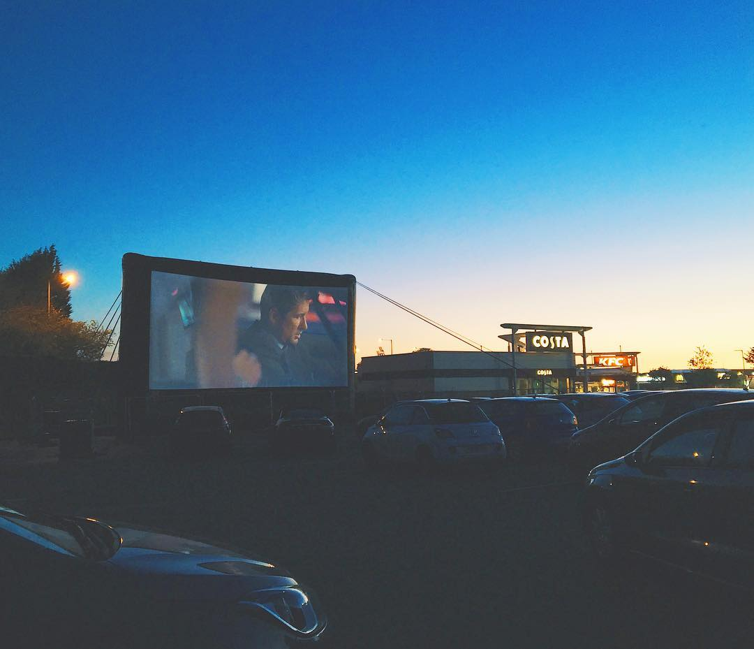 Drive in cinema surrounded by cars