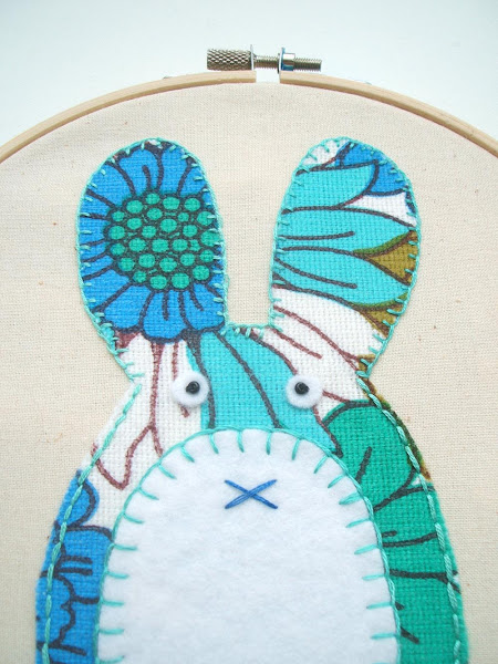 close up detail of my latest crafting project, a vintage fabric applique bunny hoop using small blanket stitches