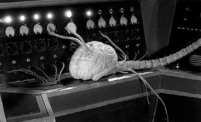 Still, a brain creature from Fiend Without a Face (1958)