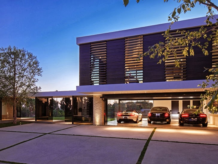 Garage with cars in Perfect modern mansion in Beverly Hills