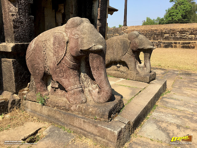A closer look at the beautifully carved elephant balustrades before the temple