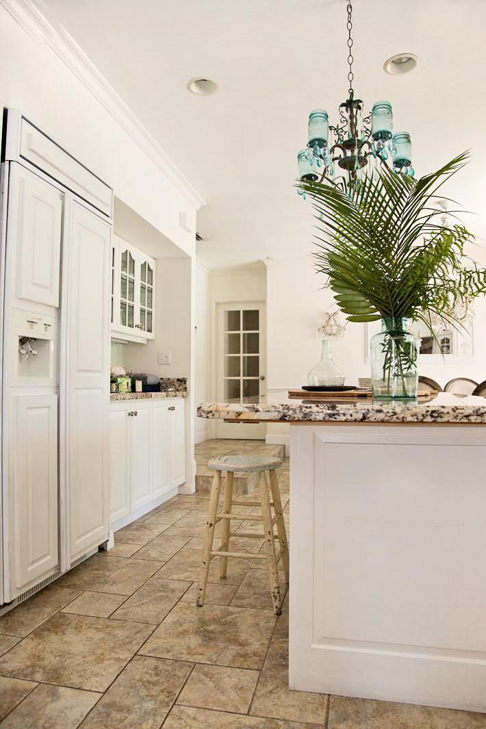 white kitchen with mason jar chandelier