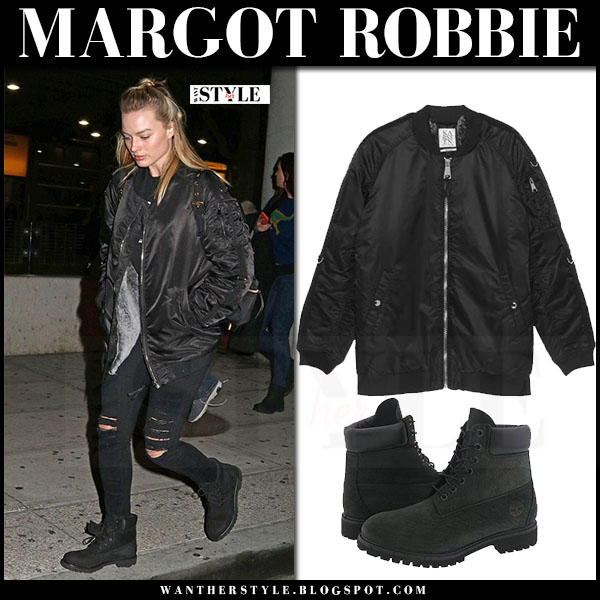 Margot Robbie in black bomber jacket, black ripped jeans and black boots timberland what she wore street style