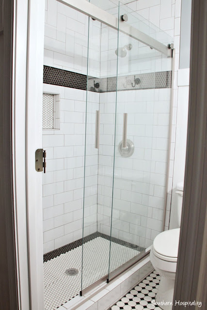 Black and white tile design in bathroom