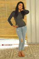 Actress Bhanu Tripathri Pos in Ripped Jeans at Iddari Madhya 18 Movie Pressmeet  0022.JPG