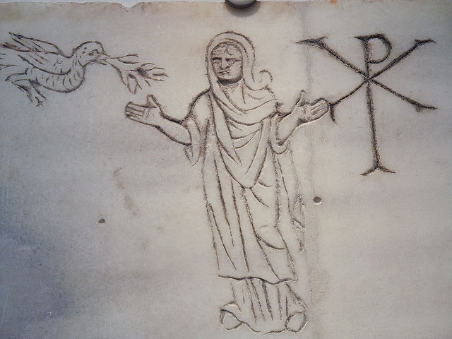 etching of a Christ figure, Chi-Roh symbol and dove that was recovered from the catacombs