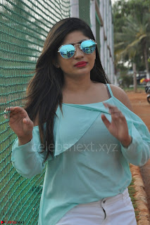 Madhulagna Das looks super cute in White Shorts and Transparent Top 07.JPG