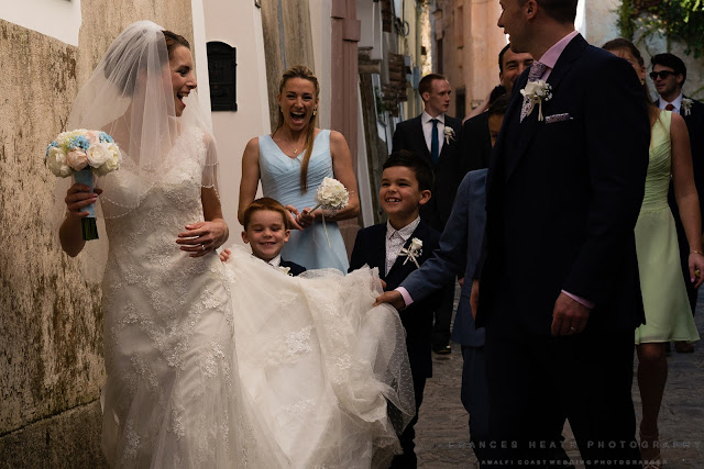 Children carry bride's dress