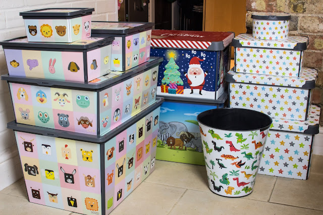 A range of different size plastic storage boxes for children