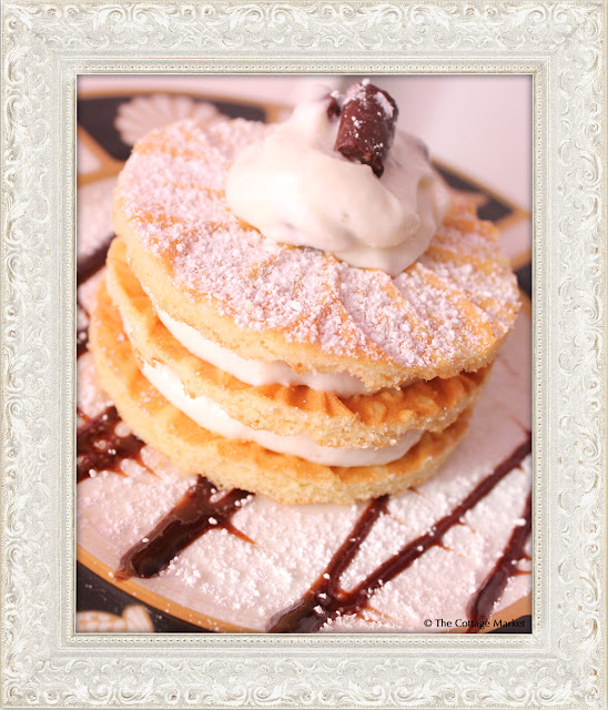 These mini pizzelles served with homemade canoli cream are a tasty treat.