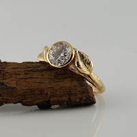 """The ring is cast in recycled, certified """"Conflict-Free"""" Gold. The Moissanite Diamond is a Round Forever One™ Moissanite Diamond by Charles & Colvard. By using the Moissanite Diamonds in our rings, this ensures you that this ring is sustainable and conflict-free ring. The rings also come with a certificate for the moissanite stone from Charles & Colvard."""
