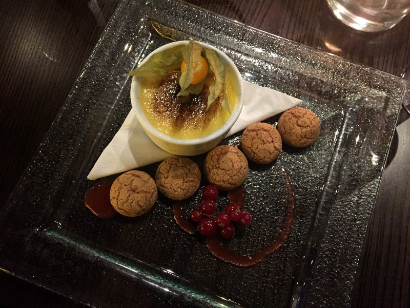 white chocolate and cardamom crème brulee with almond biscuits