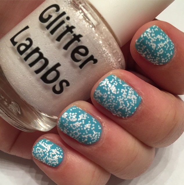 Christmas custom handmade indie nail lacquer for the holiday season for your nails. White glitter topper nail polishes.