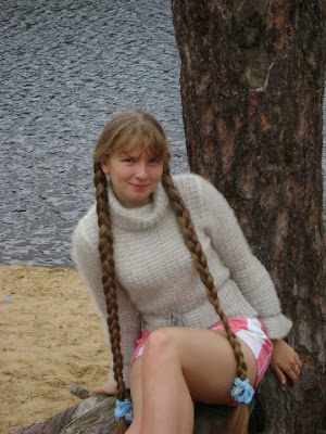 Blond Rapunzel girl with two long braids