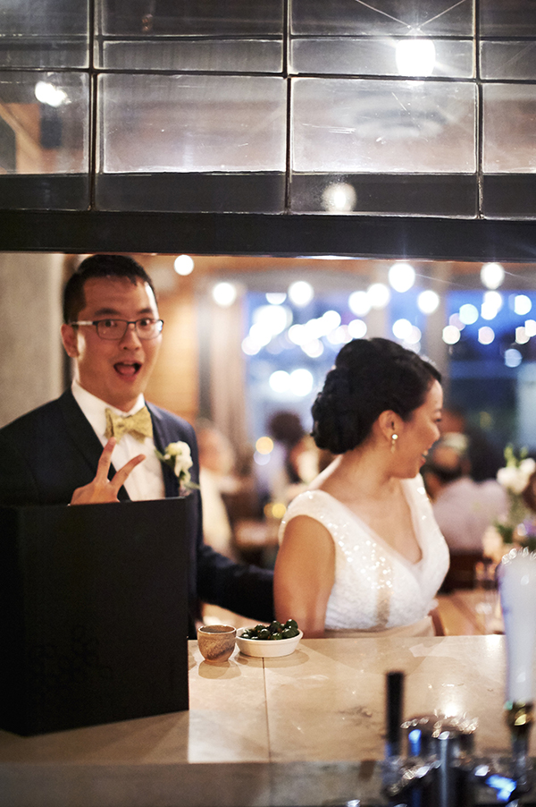 Bride and groom ordering a drink at Chambar wedding reception
