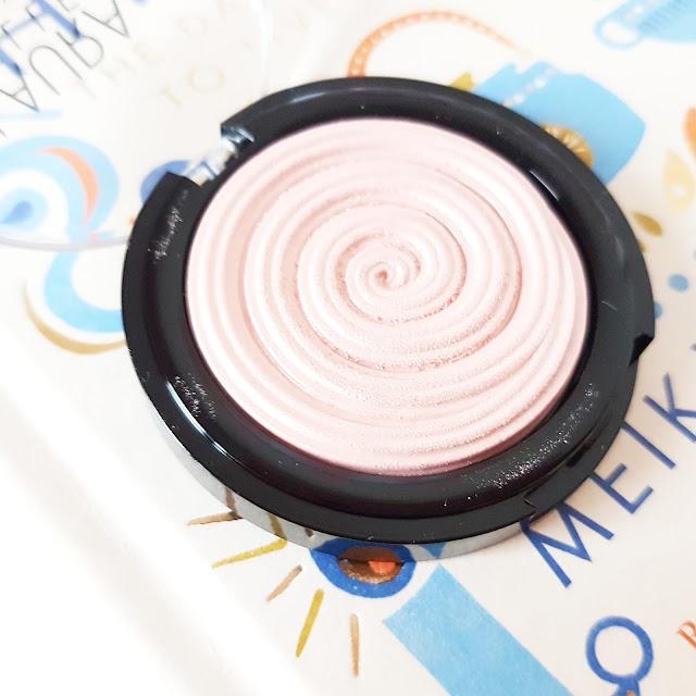 Laura Geller Baked Gelato Swirl Illuminator in Charming Pink