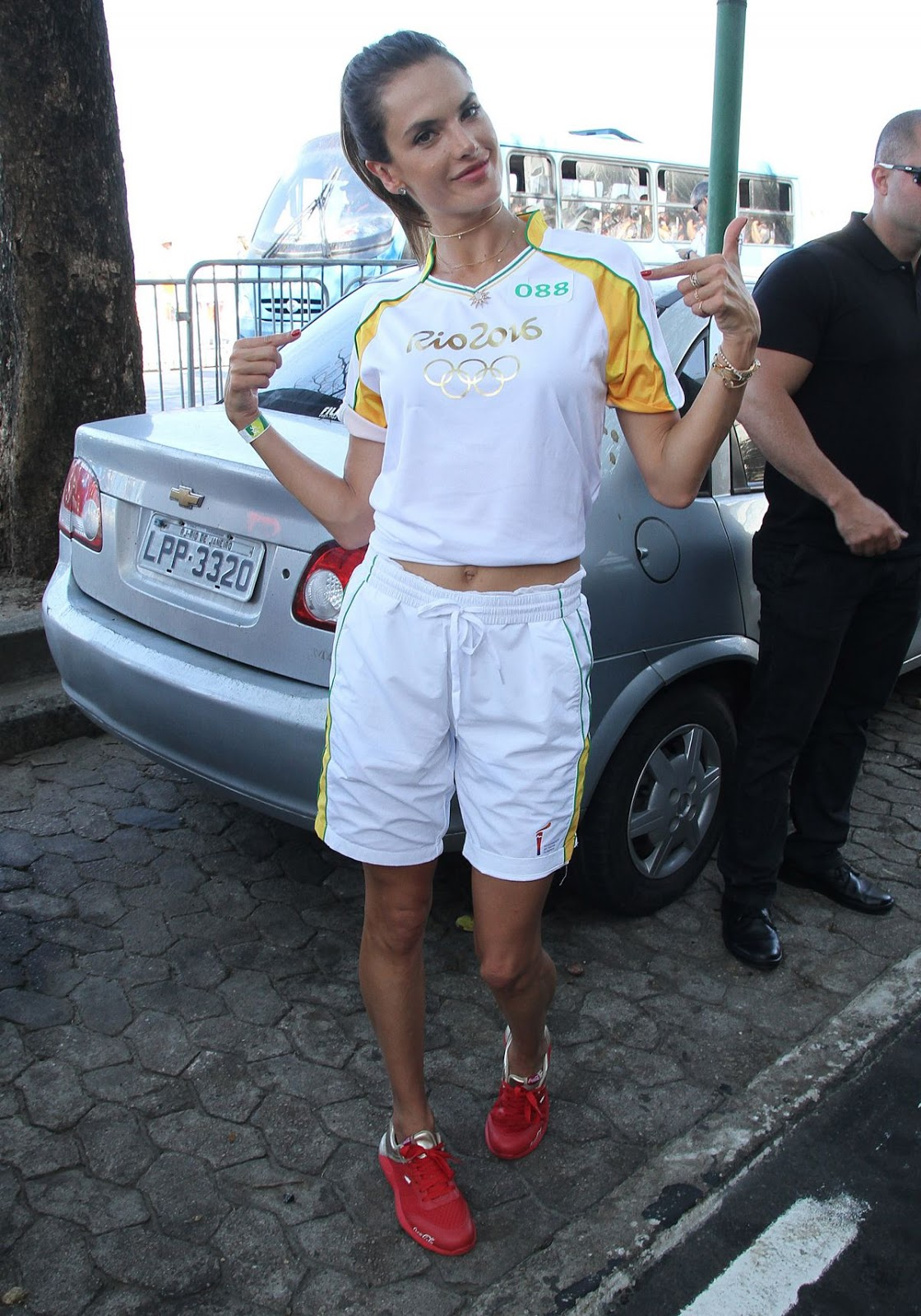Alessandra Ambrosio Runs with Olympic Flame Through Rio De Janeiro