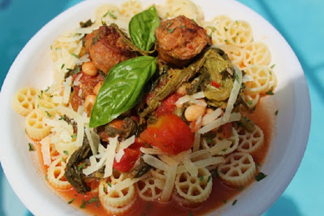 This is a soup with wagon wheel pasta, Italian sausage and greens