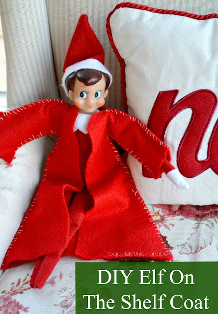 Elf On The Shelf In  A Red Coat With DIY Elf On The Shelf Coat Text