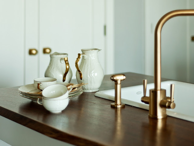 remodeled new york brownstone brass faucet and wood top island
