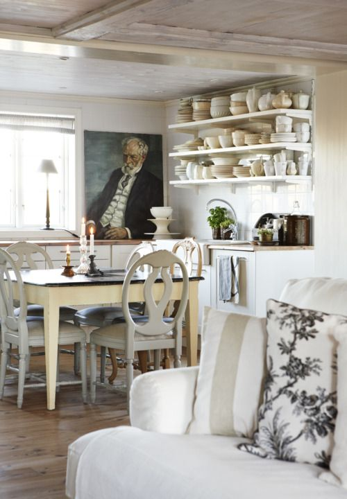 Intriguing Swedish farmhouse style kitchen with open shelves and oil portrait - found on Hello Lovely Studio