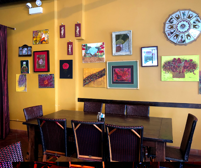 Cafe Aroma is decorated with rich, warm hues and art painted by Mitra Ryndak herself!