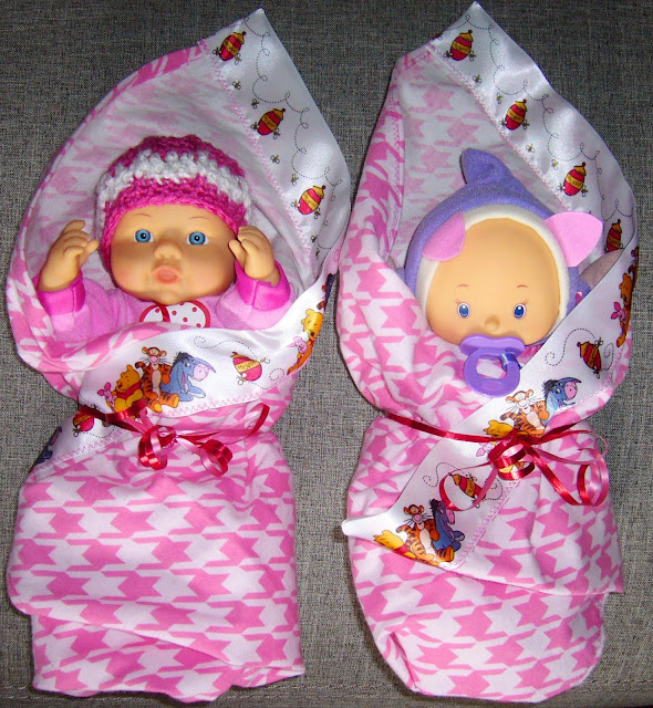 Baby dolls with hats and blankets crafted for Operation Christmas Child shoe box packing.