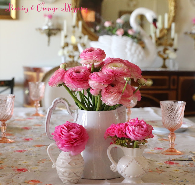 Pink ranunculus and geraniums in a pretty French pitcher