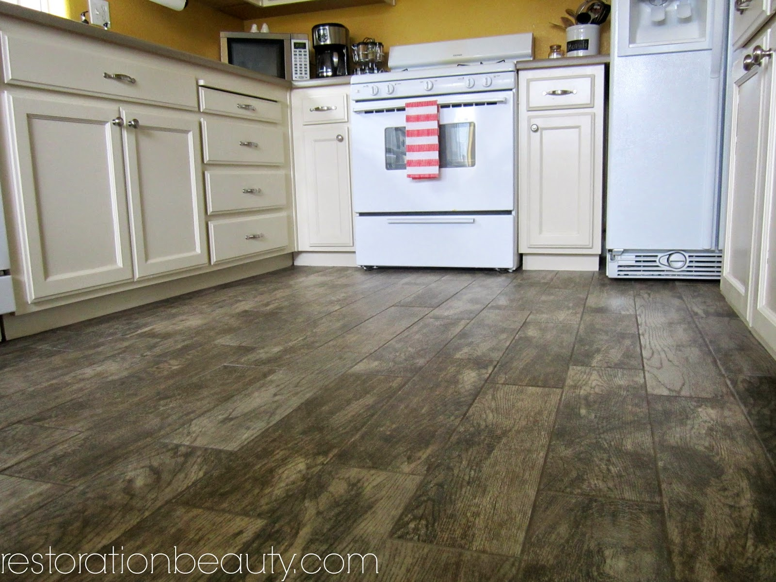 rustic wood floor tile.  Restoration Beauty Faux Wood Tile Flooring In The Kitchen