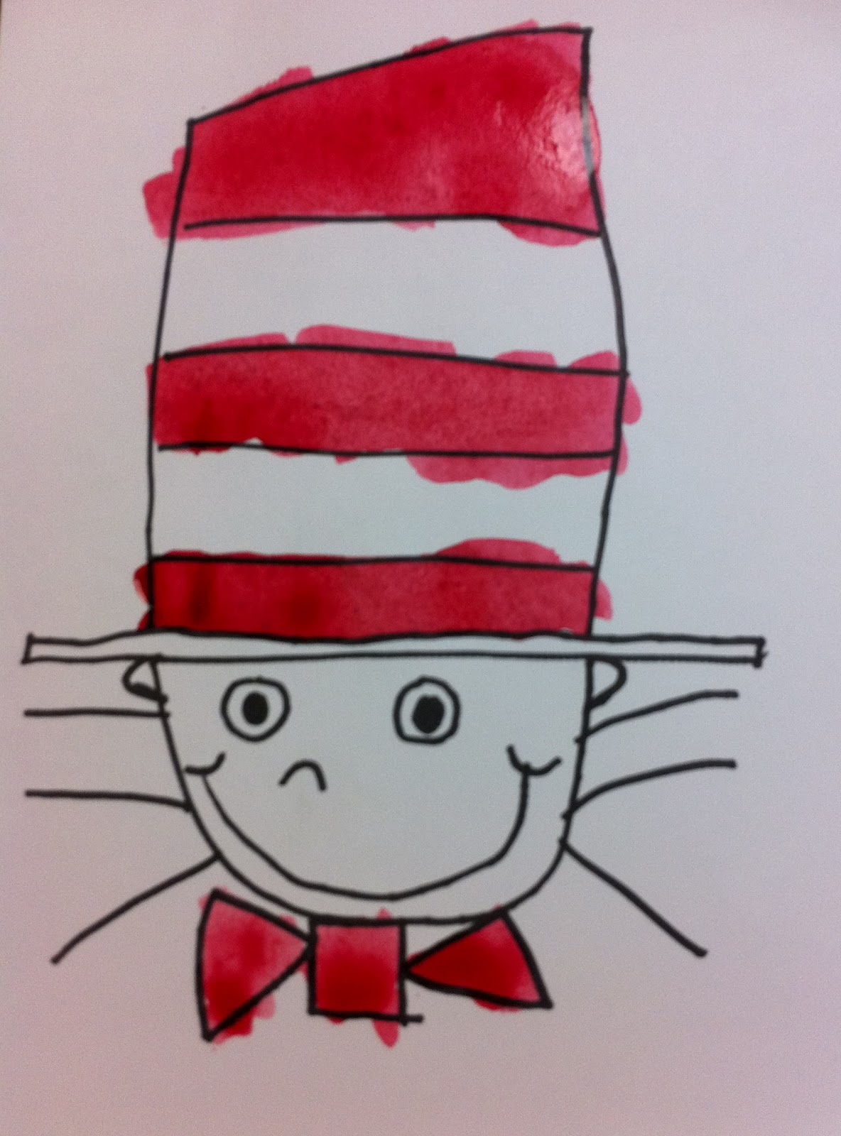 It is a photo of Zany Drawing Cat In The Hat