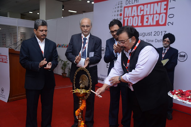 Mr. Rattan Kapur(in the right) ligting the lamp at Delhi Machine Tool Expo 2017 followed by Mr. P. Jadeja, Mr. P Ramdas and Mr. V. Anbu_