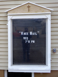 """knee mail"" on signboard at Dillon, Montana, Assembly of God Church"