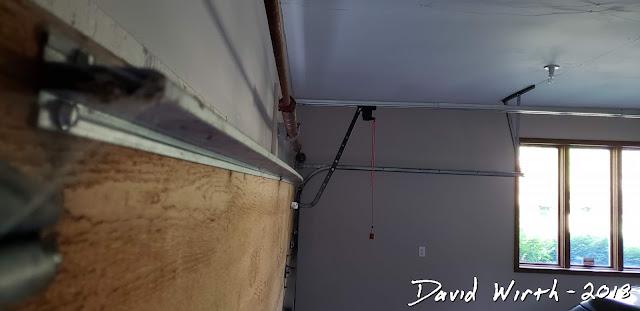 new strut for bent garage door