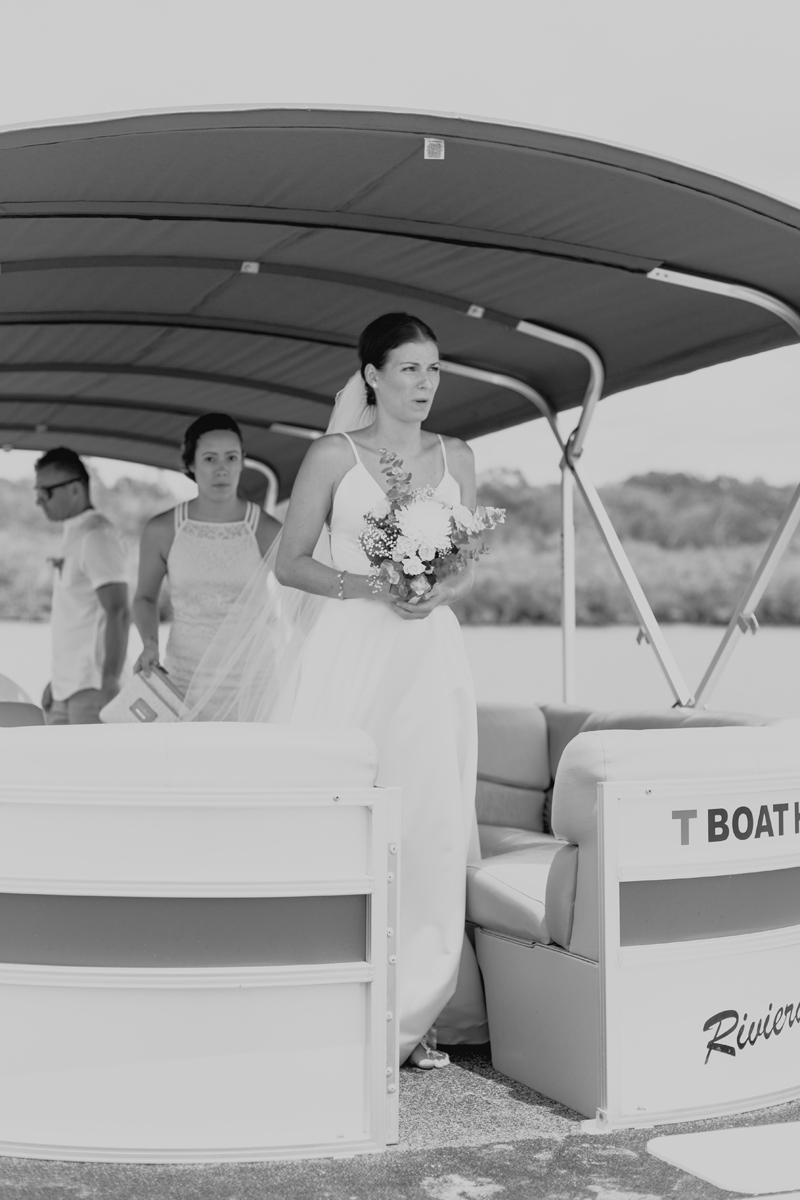 bride getting off boat