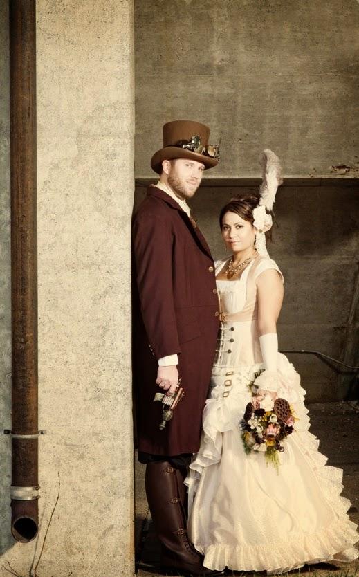 Steampunk wedding couple wedding dress feather top hat gun suit