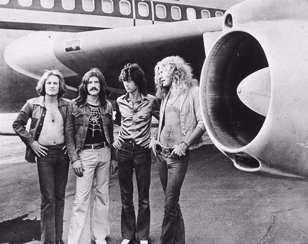 British Rock Band Led Zeppelin Left To Right John Paul Jones Bonham Jimmy Page And Robert Plant Pose In Front Of Their Private Airliner The