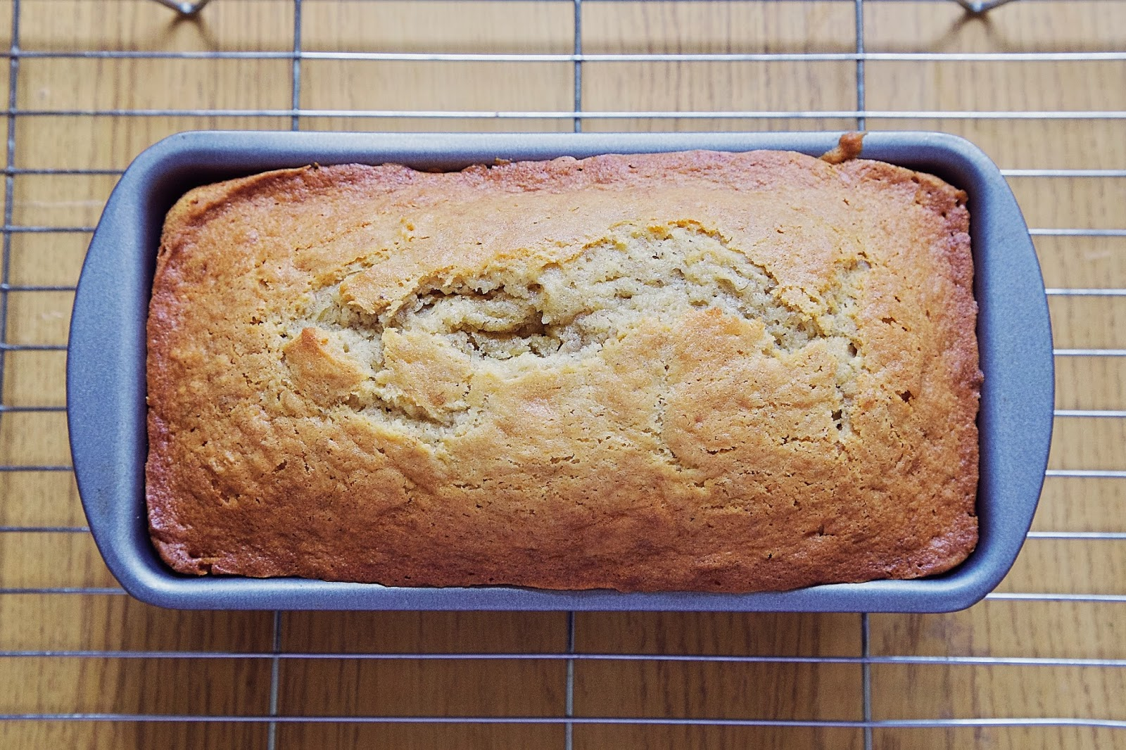 Baked banana bread cooling in tin