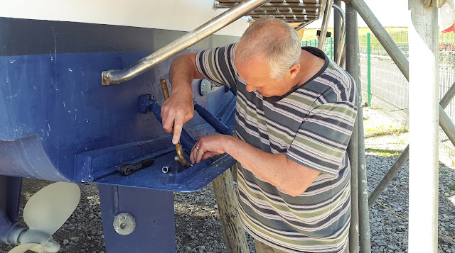 Photo of Phil removing the old trim tab rams